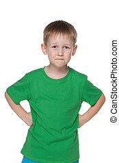 Smiling little boy in a green shirt
