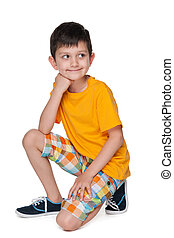 Smiling little boy in a yellow shirt