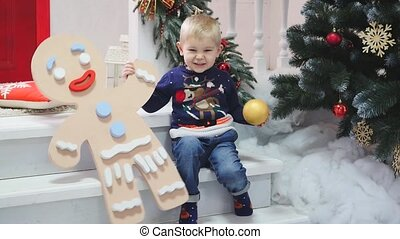 Smiling little boy in Christmas decoration. New Year