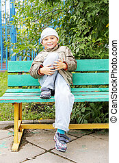 Smiling little boy on bench