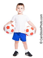 Smiling little boy posing with a two soccer balls. Isolated...