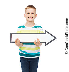 smiling little boy with blank arrow pointing right