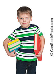 Smiling little boy with books