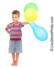 Smiling little boy with color balloons