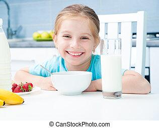 little girl at the breakfast