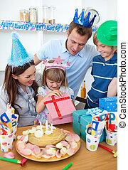 Smiling little girl celebrating her birthday