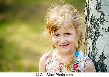 smiling little girl - Cute little girl walking in a summer...