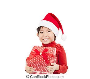 smiling little girl holding christmas gift