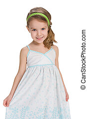 Smiling little girl in a fashion dress