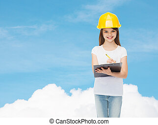 smiling little girl in hardhat with clipboard - childhood, ...