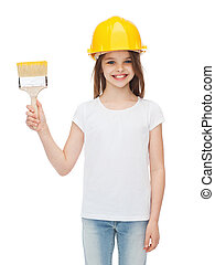 smiling little girl in helmet with paint brush