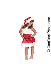 Smiling little girl in Santa Claus costume is posing