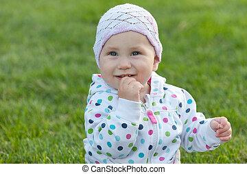 Smiling little girl in the polka dot jacket