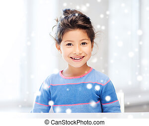 smiling little girl indoors - childhood and people concept -...