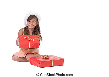 Smiling little girl is holding Christmas gift