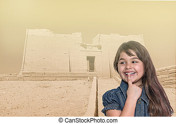Smiling little girl is standing in front of Temple of Kalabsha