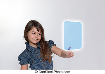 Smiling little girl is touching transparent rectangle by her index finger