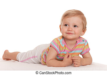 Smiling little girl lying on the white