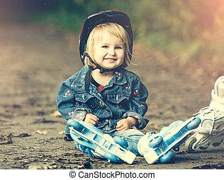 little girl on roller skates