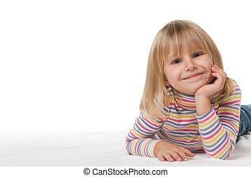 Smiling little girl on the white