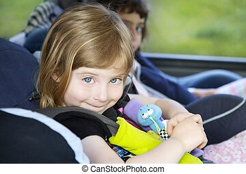 smiling little girl safety belt car security chair