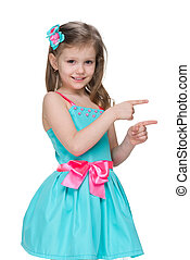 Smiling little girl shows her fingers to the side