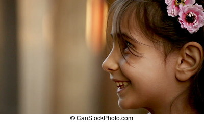 Smiling Little Girl Side Closeup Portrait - Portrait of...