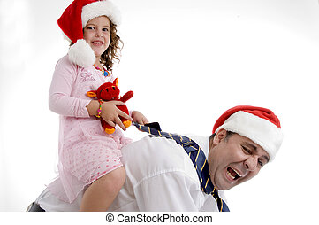 smiling little girl sitting on her father's back