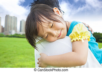 smiling little girl sleeping on his father shoulder