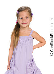 Smiling little girl stands