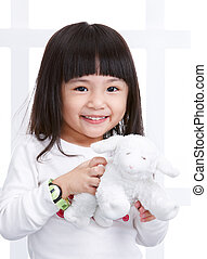little girl - smiling little girl with a soft toy