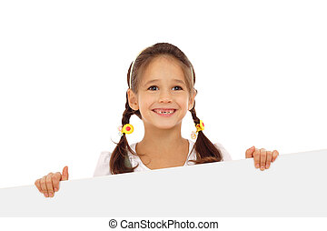 Smiling little girl with an empty banner, isolated on white