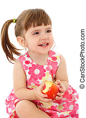 Smiling little girl with apple, isolated on white
