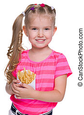 Smiling little girl with fries - A smiling little girl with ...
