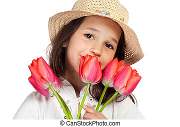 Smiling little girl with red tulips