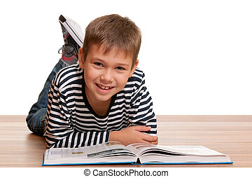 Smiling little reader - A handsome smiling kid is reading a ...