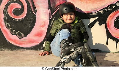 Smiling little skater - Portrait of a young skater with...