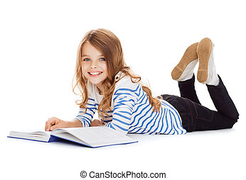 smiling little student girl lying on the floor - education...