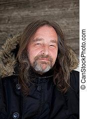 Smiling Long Hair Adult Man Wearing Hooded Jacket