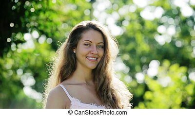 smiling long-haired woman - portrait of smiling long-haired...