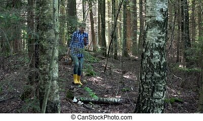 smiling lost mushroom picker woman holding cellphone with...