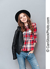 Smiling lovely woman wearing plaid shirt and leather jacket