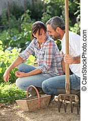 Smiling lovers doing gardening
