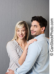 Smiling loving young couple