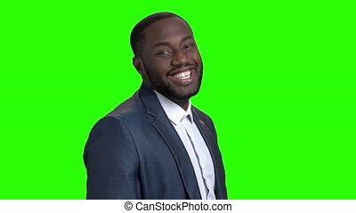 Smiling macho-man on green screen.