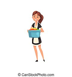 Smiling maid holding a basin with clean linen, housemaid character wearing classic uniform with black dress and white apron, cleaning service vector Illustration