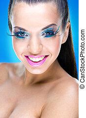 Smiling  Makeup  Model with extreme makeup