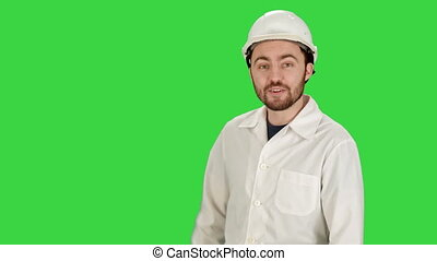 Smiling male architect with talking on camera on a Green Screen, Chroma Key.