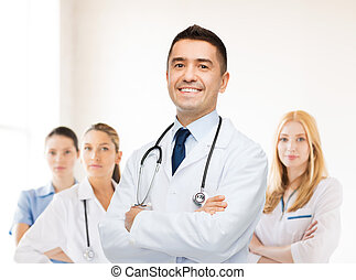 smiling male doctor in white coat at hospital - healthcare,...