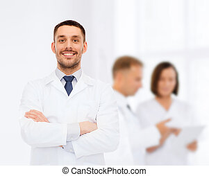 smiling male doctor in white coat - healthcare, profession...